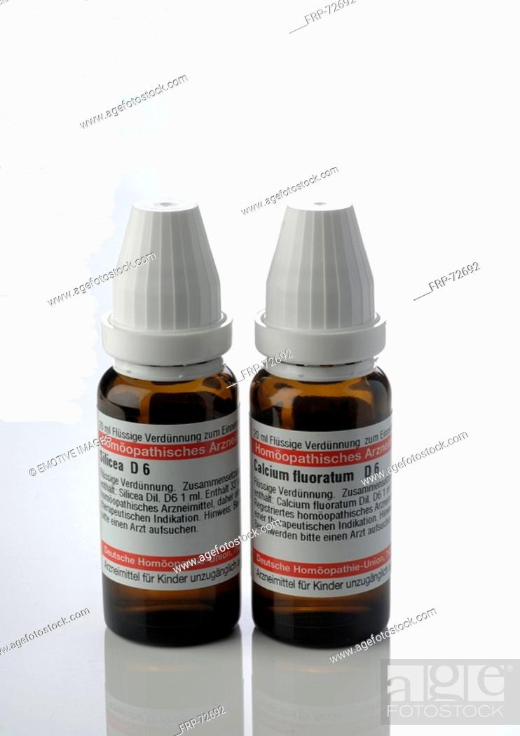 Stock Photo: Small bottles with globules.