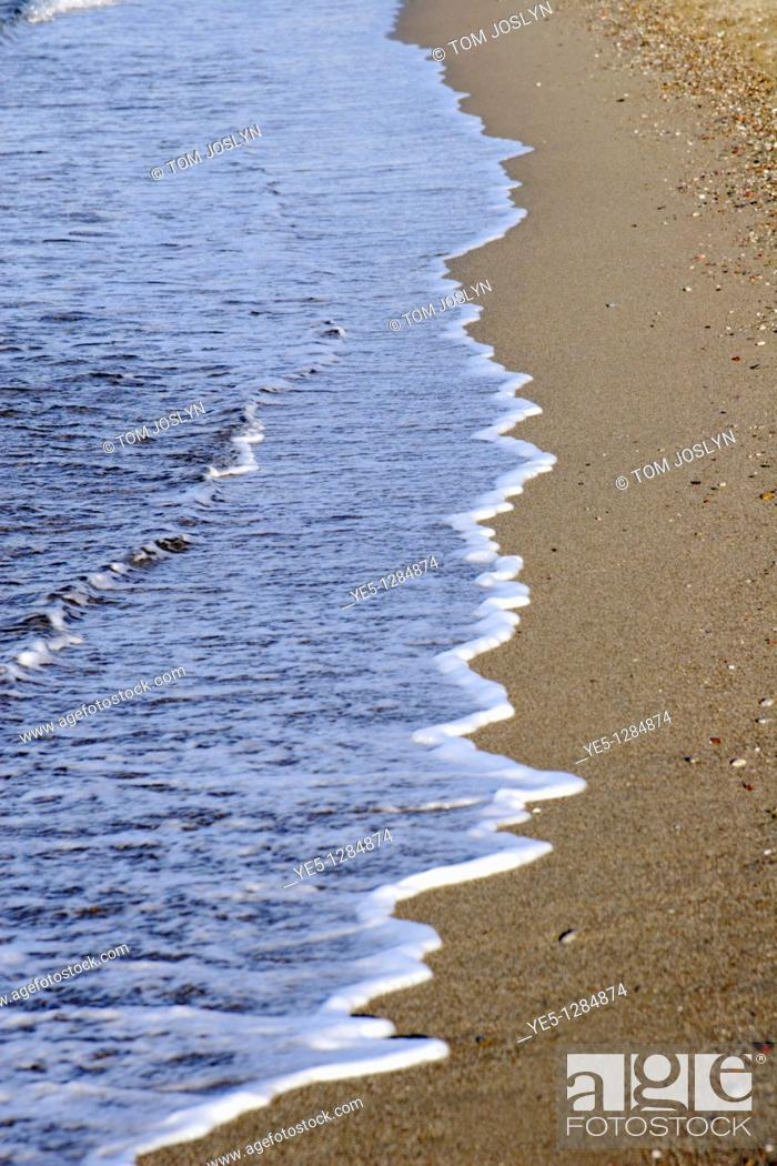 Stock Photo: Waves washing up on sandy beach, Rhodes, Greece.