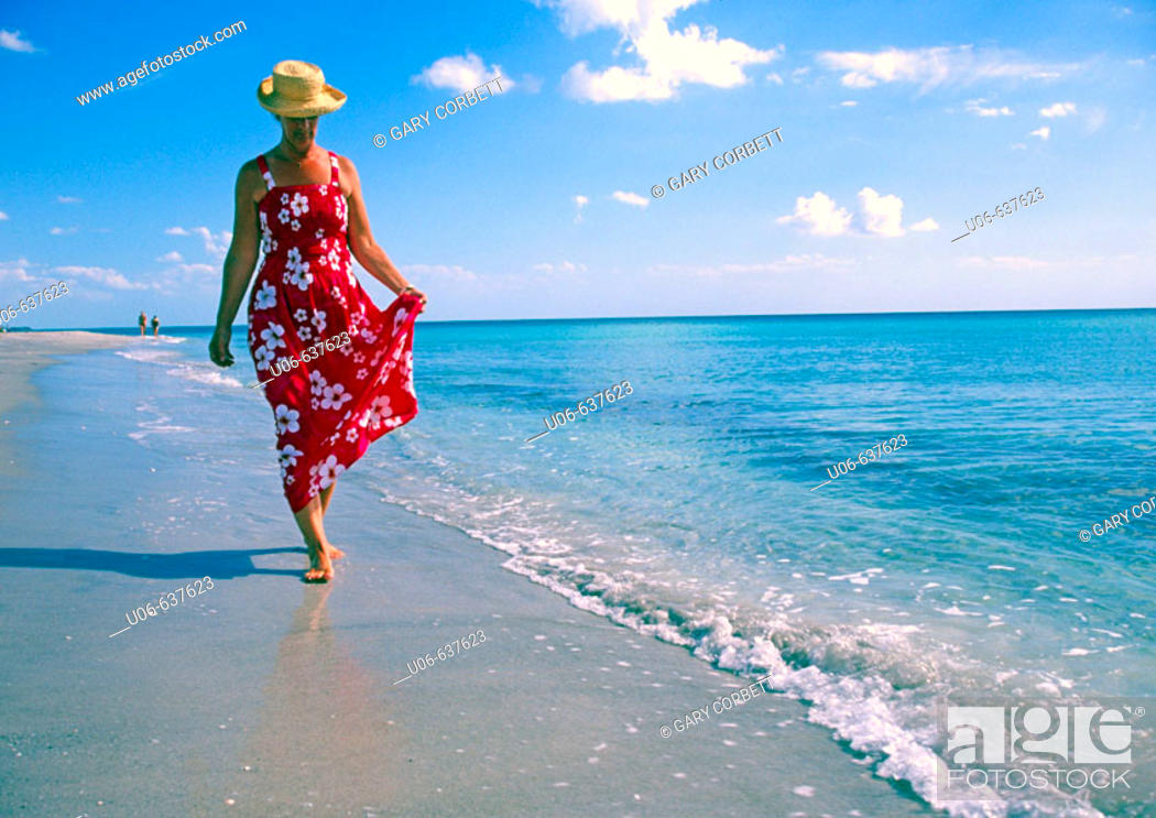 Stock Photo: Woman in a nice dress walking, Casperson beach at Venice, Florida (USA).