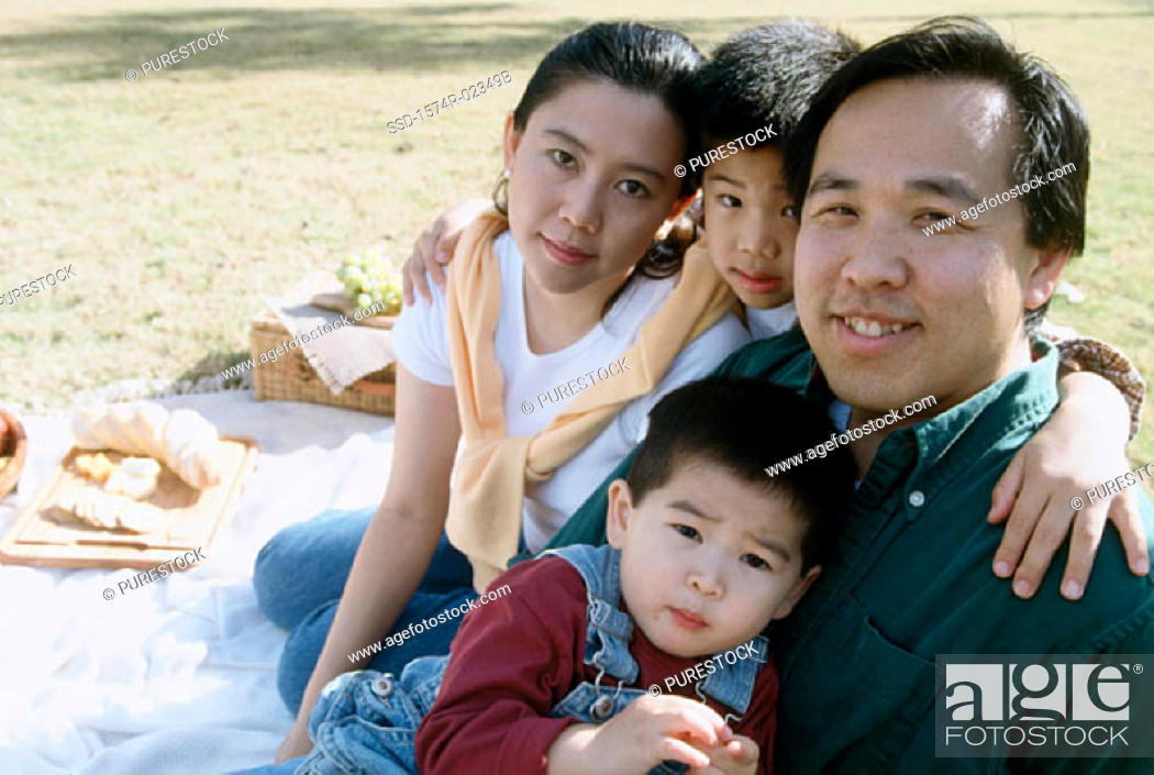 Stock Photo: Portrait of parents with their children at a picnic.
