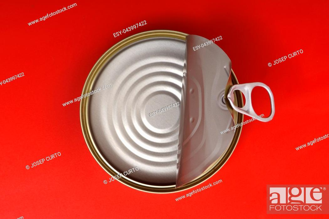 Stock Photo: can isolated on red background.