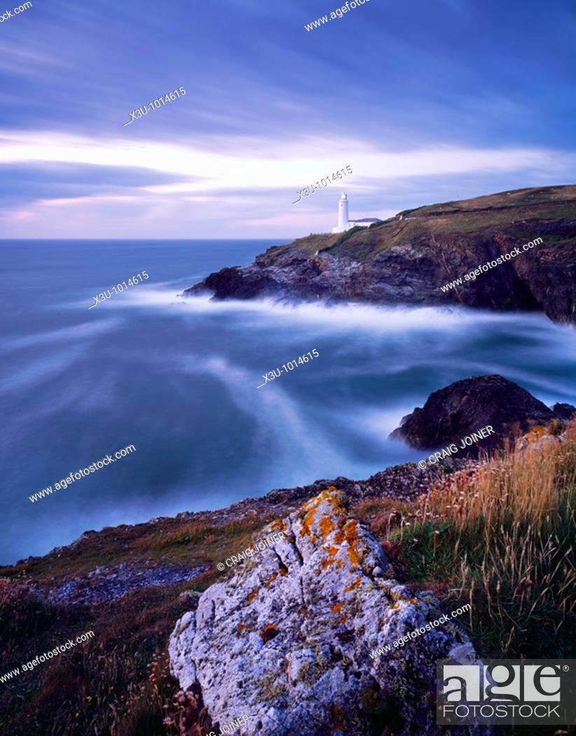 Stock Photo: Stinking Cove and the lighthouse at Trevose Head at dusk viewed from Dinas Head on the North Cornwall coast near Padstow, Cornwall, England, United Kingdom.