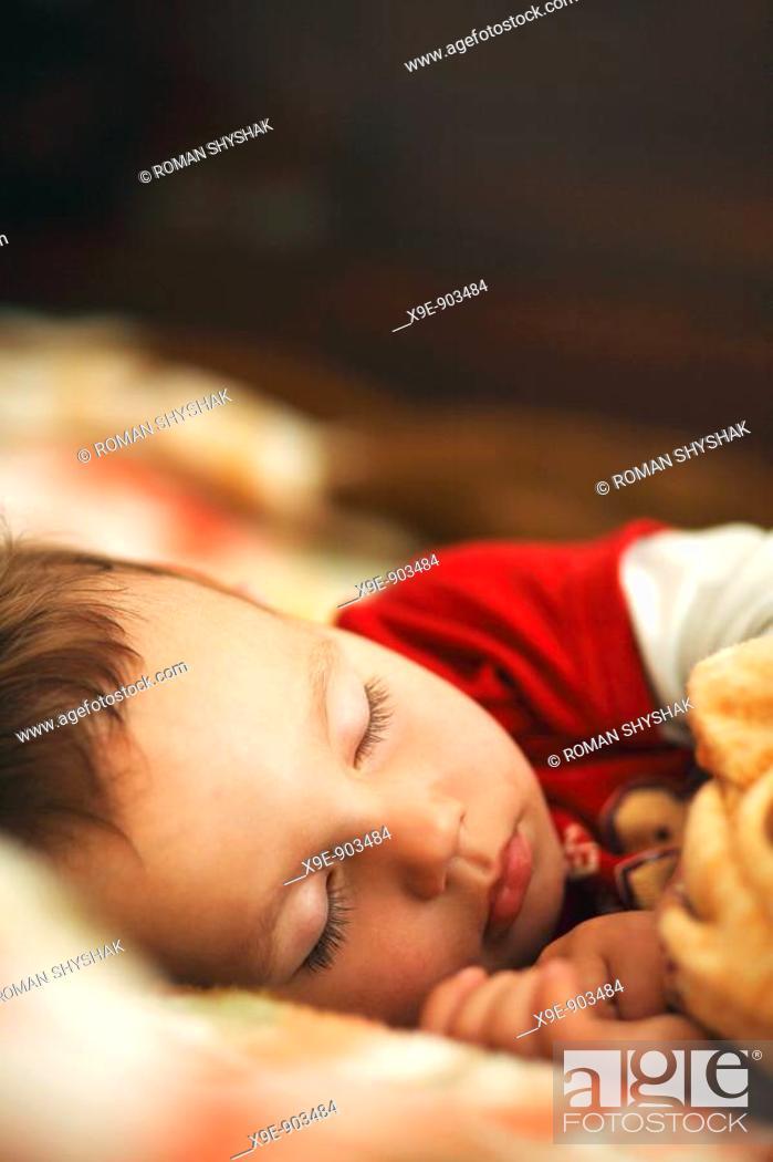 Stock Photo: A little boy sleeping.