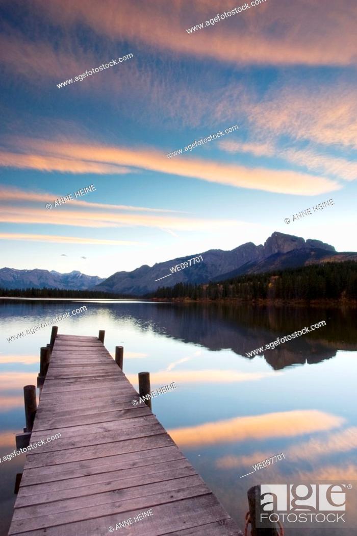 Stock Photo: catwalk at mountain lake after sunset.
