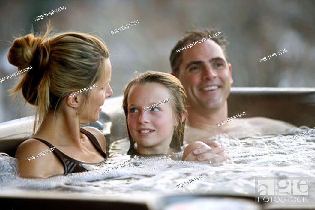 Mature hot tub couple