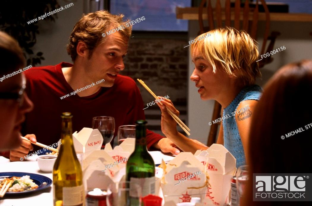 Stock Photo: Couple at Dinner Party.