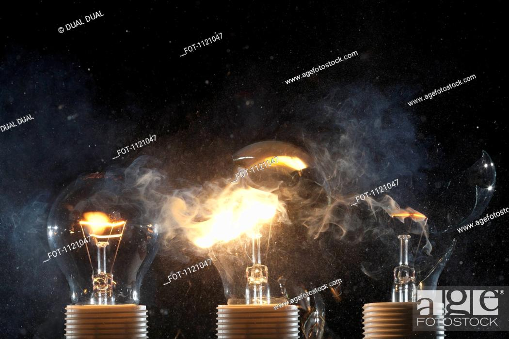 Stock Photo: Burning and exploding light bulbs.