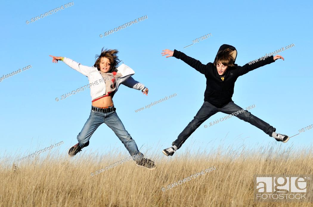 Stock Photo: Two boys jumping.