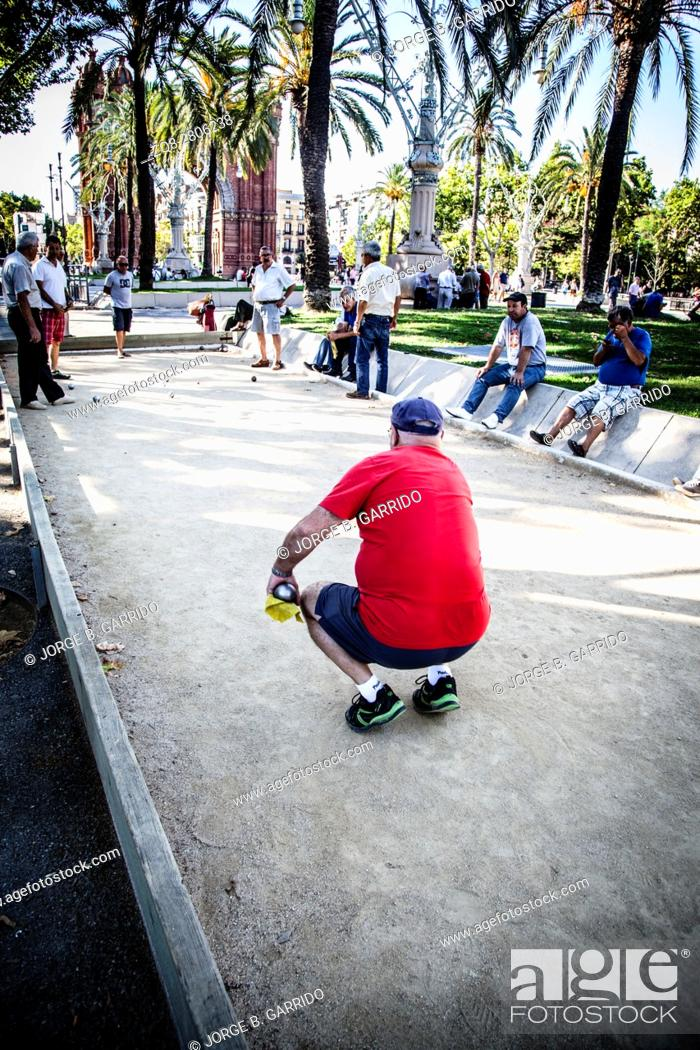 Stock Photo: People playing pétanque at Parc de la Citadella, Barcelona.