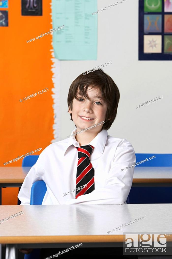 Stock Photo: Boy 10-12 wearing shirt and tie in classroom.