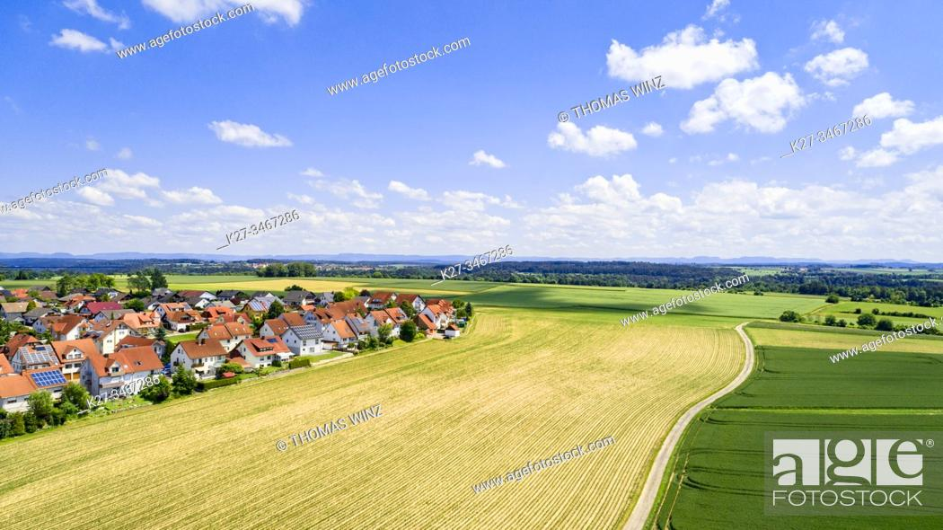 Stock Photo: New homes next to agricultural fields and path from above, Baden Württemberg, Germany.