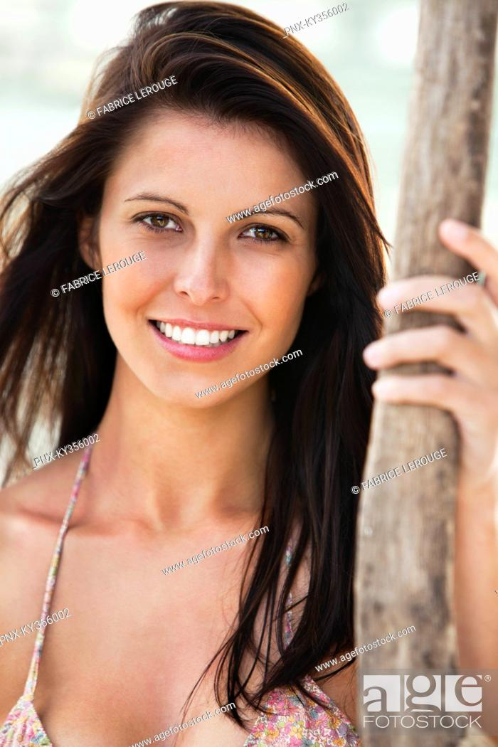 Stock Photo: Portrait of a woman smiling.