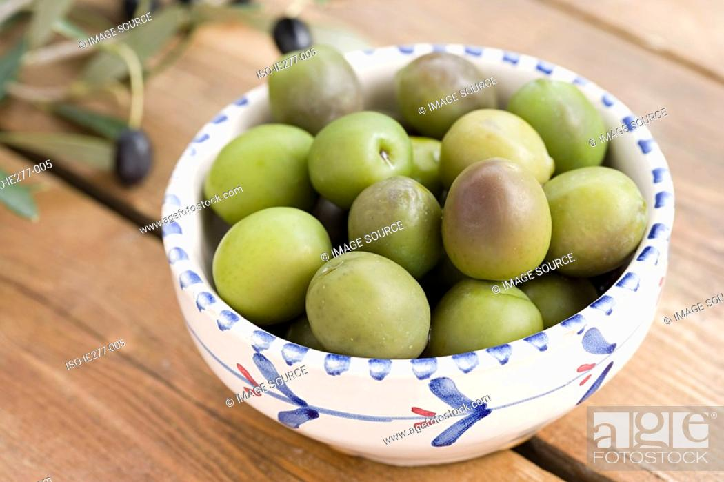 Stock Photo: Green olives in a bowl.