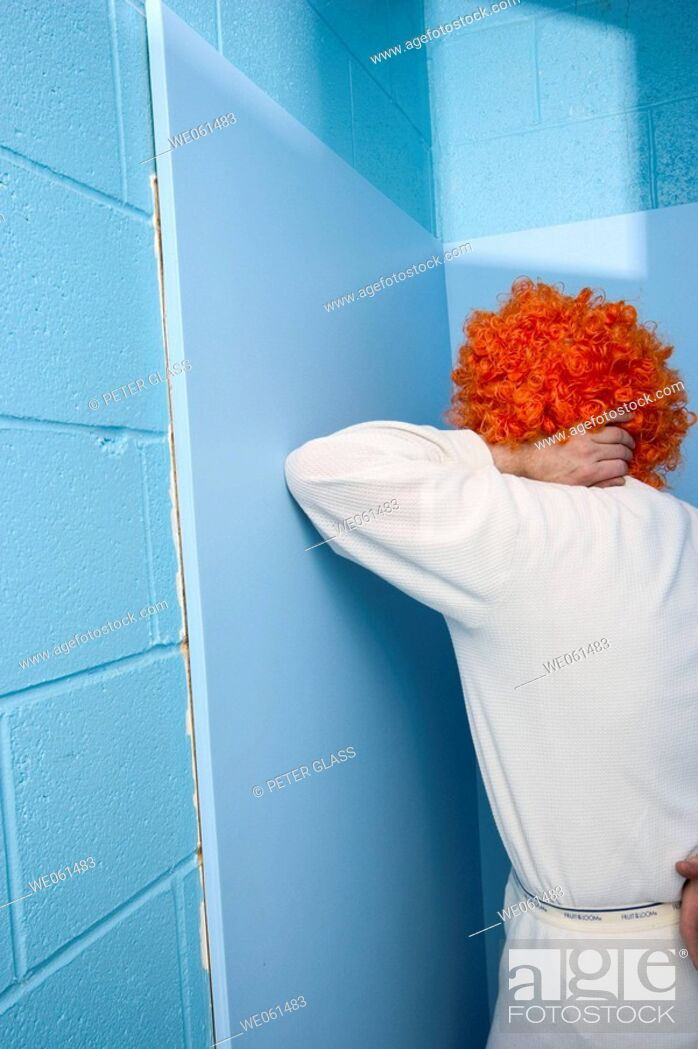 Stock Photo: Man posing in his long underware and an orange wig.
