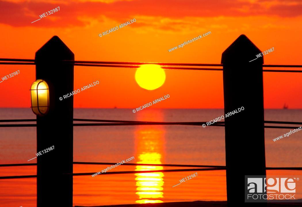 Stock Photo: Orange Setting Sun In the Florida Keys.