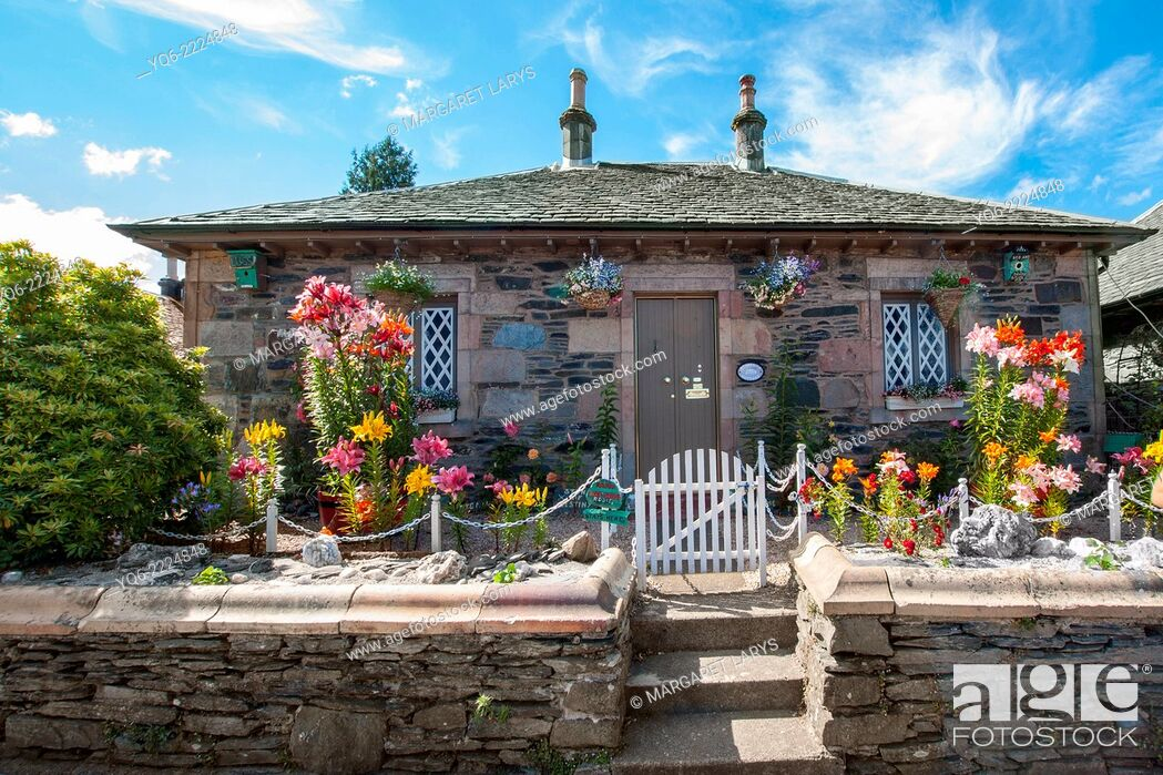 Stock Photo: A house with a beautiful front garden in Luss, Scotland.