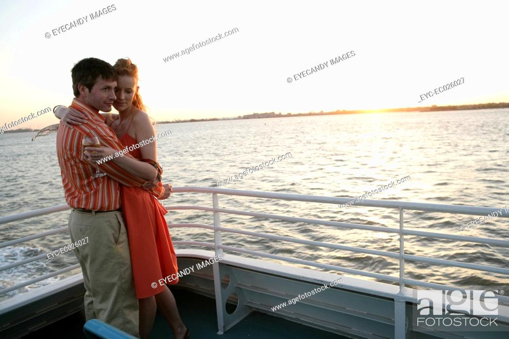 Stock Photo: Couple embracing on a boat.