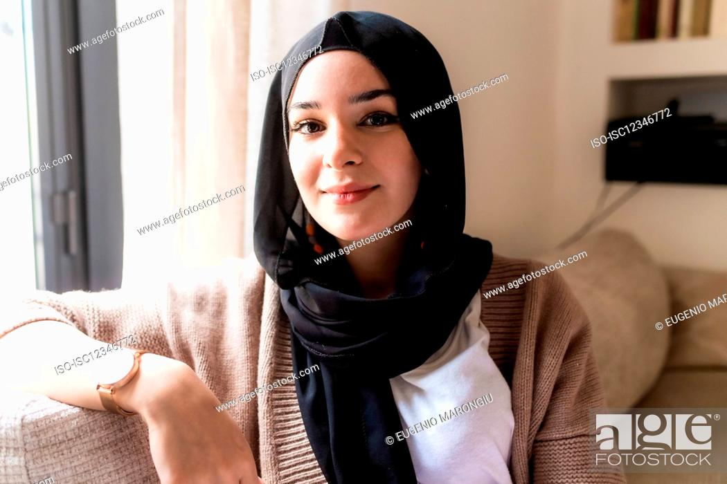 Stock Photo: Portrait of young woman wearing hijab.