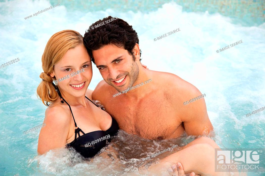 Stock Photo: Young couple in hot tub, portrait.