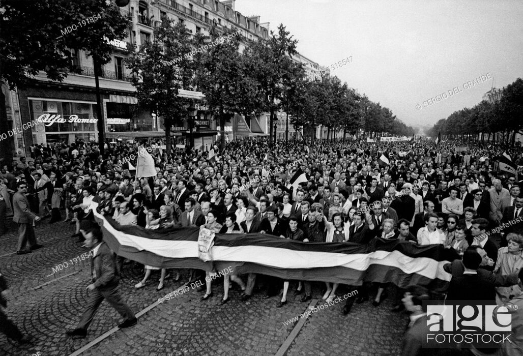 Stock Photo: A huge crowd demonstrating nearby the Place de la Concorde to support the President of French Republic Charles de Gaulle during the May 1968 events in France.