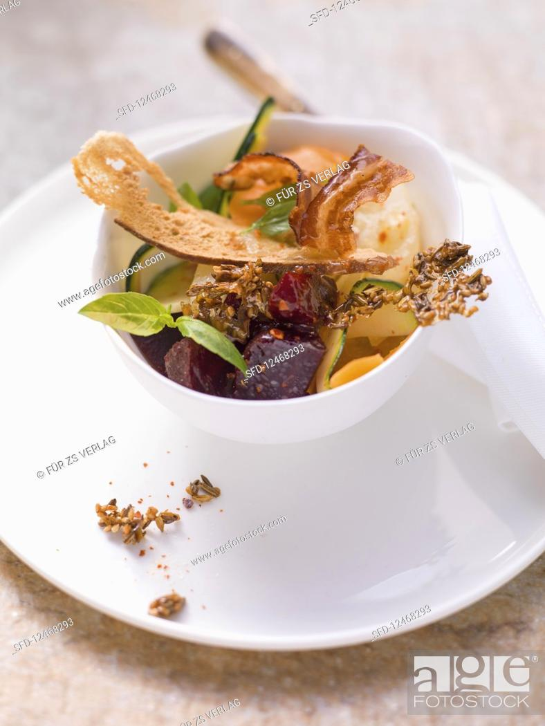 Stock Photo: Vegetable salad with sesame brittle, bacon and pretzel chips.