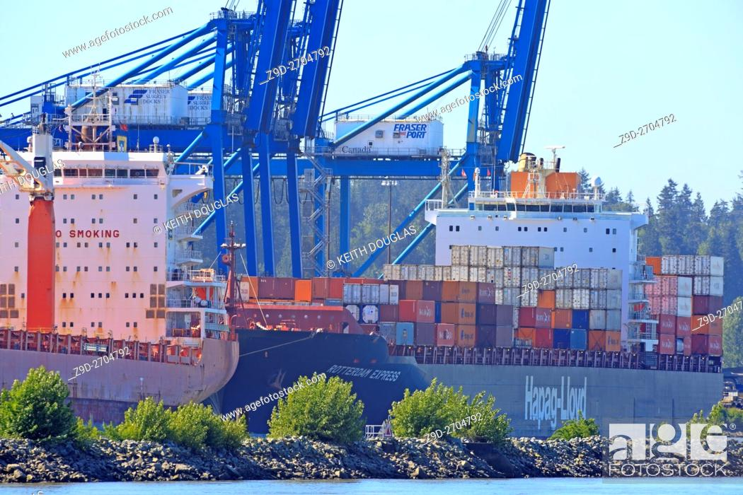 Stock Photo: Ships at container terminal on Fraser River, Surrey, British Columbia.