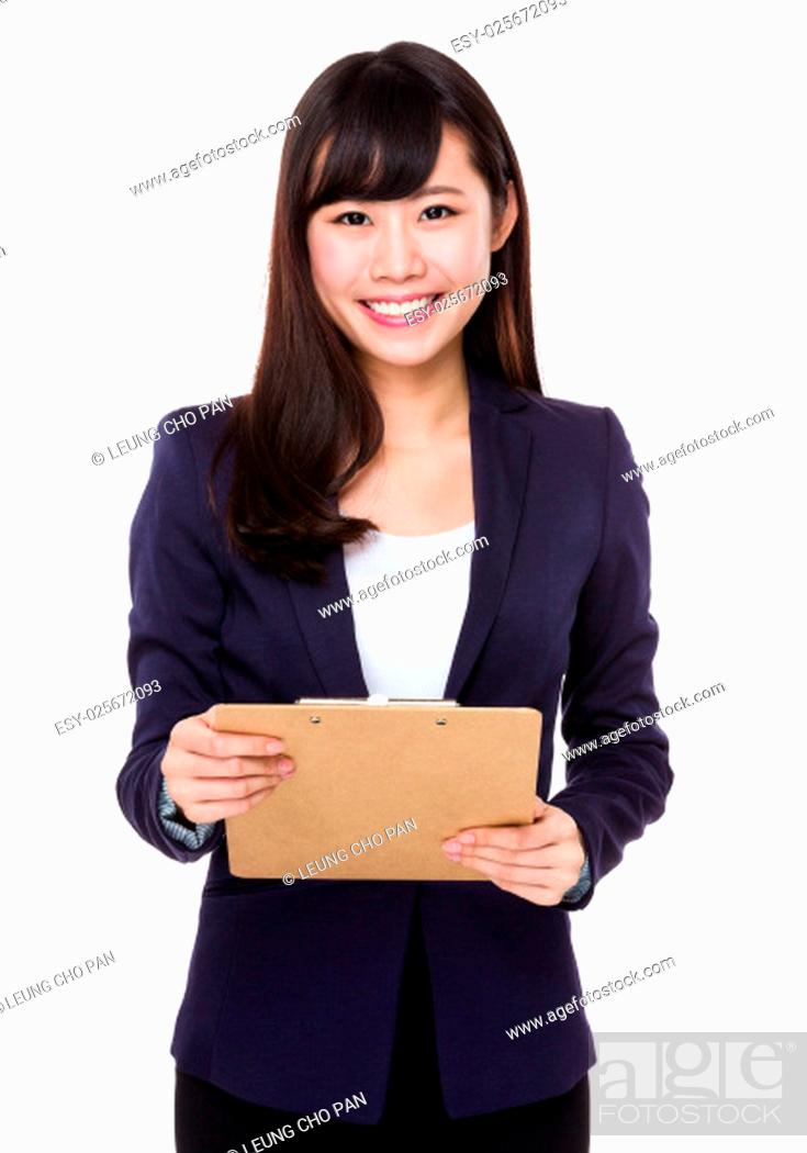Stock Photo: Asian Businesswoman hold with clipboard.