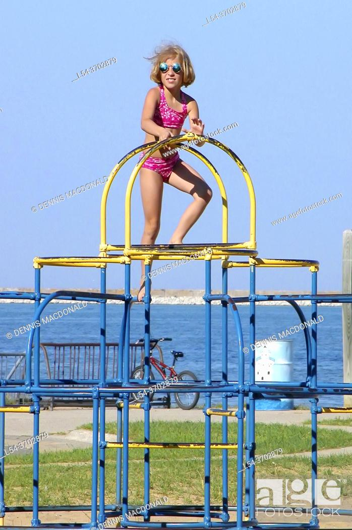 Stock Photo: Kids play and climb on 'monkey bars' - unsafe by government standards.
