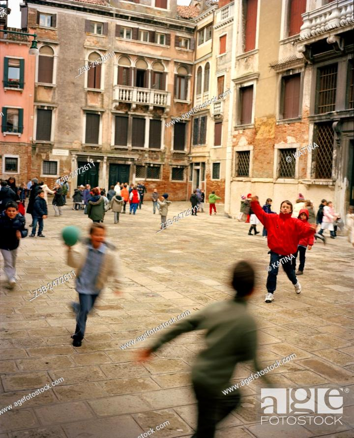 Stock Photo: Children playing dodgeball at school, Venice, Veneto province, Italy, Europe.