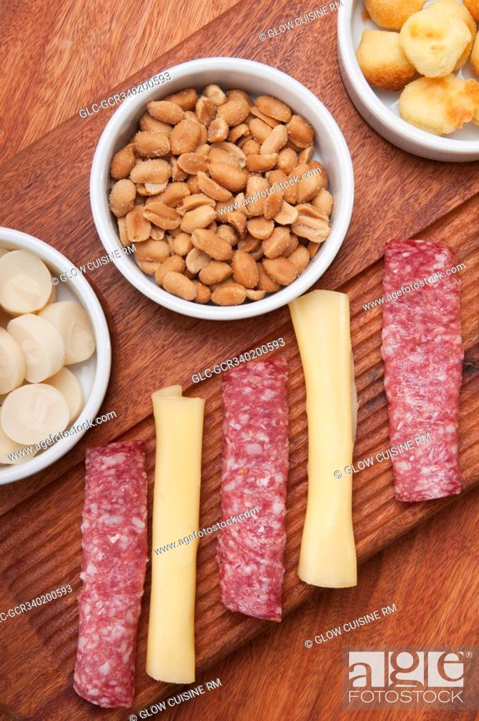Stock Photo: High angle view of ham and cheese rolls served with nuts and fruit.
