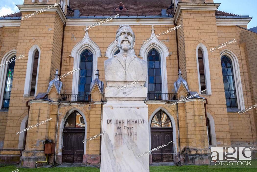 Stock Photo: Dr Ioan Mihaly de Apsa statue in front of Reformed church in Sighetu Marmatiei city in Maramures County of northwestern Romania.