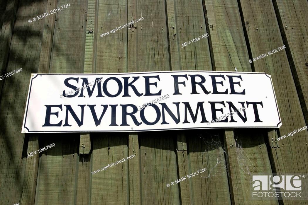 Stock Photo: Sign - smoke free Èno smokingi environment notice on cafe Rotorua,. North Island, New Zealand.