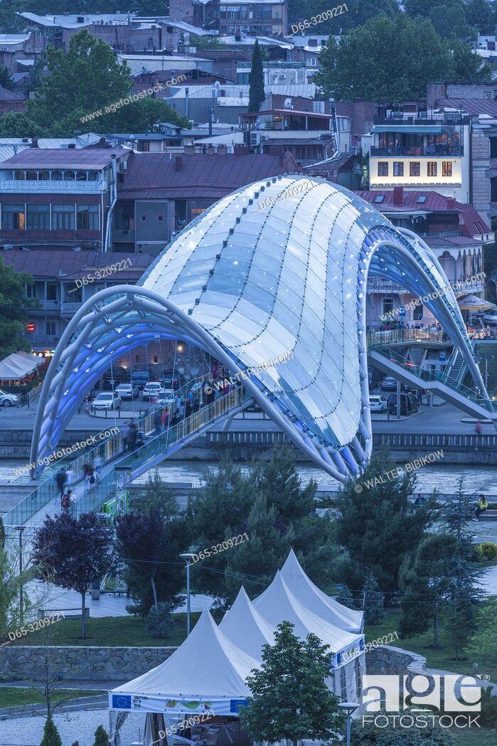 Stock Photo: Georgia, Tbilisi, Peace Bridge, dusk.