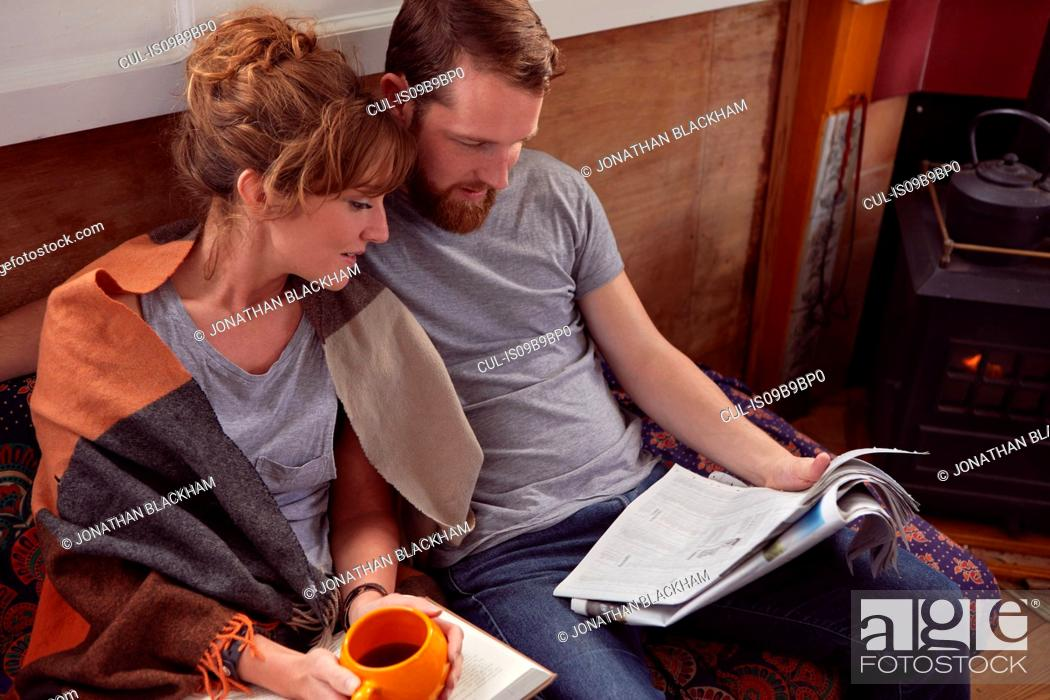 Stock Photo: Couple reading together.