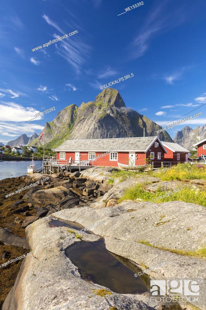Stock Photo: Typical houses of fishermen called Rorbu framed by rocky peaks and blue sea Reine Moskenes Lofoten Islands Norway Europe.