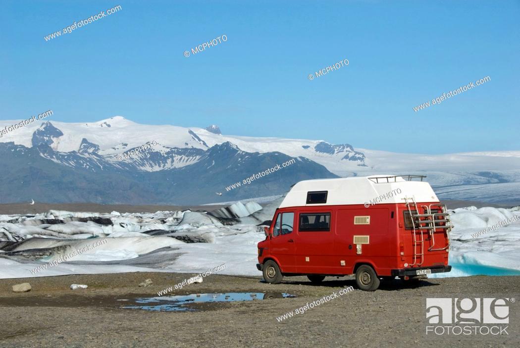Stock Photo: motor caravan at the shore of glacial lake Joekulsarlon full of melting ice in front of glacier Breidamerkurjoekull, Iceland.