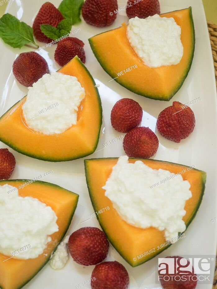 Stock Photo: Cantaloupe and cottage cheese.