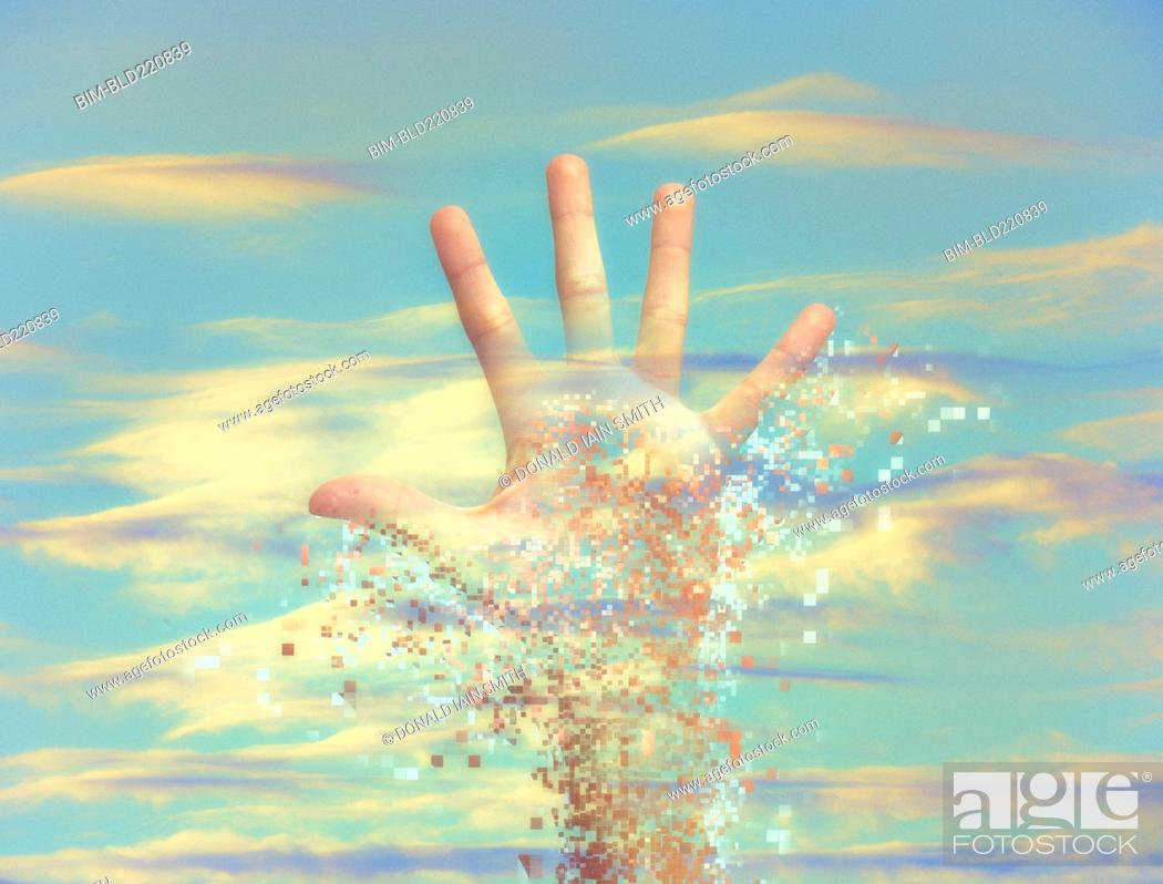 Stock Photo: Pixelated hand dissolving in sky.