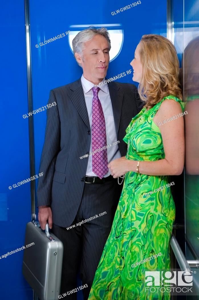 Stock Photo: Mature couple in an elevator.