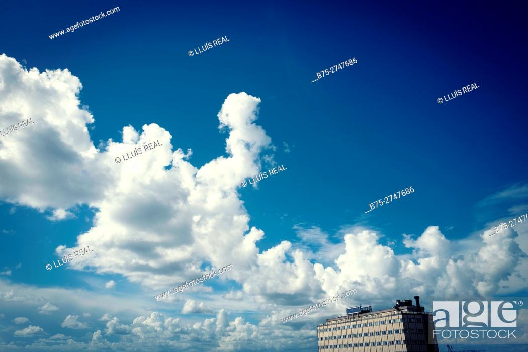 Stock Photo: Building, clouds and blue sky. Genova, Italy.