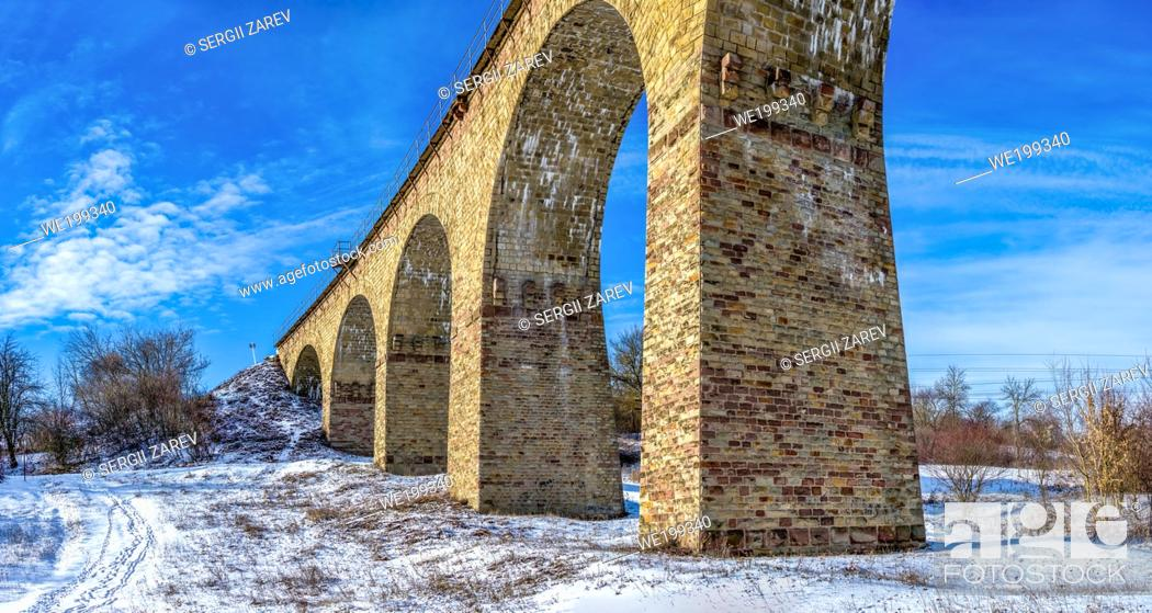 Stock Photo: Plebanivka, Ukraine 01. 06. 2020. Viaduct in Plebanivka village, Terebovlyanskiy district of Ukraine, on a sunny winter day.
