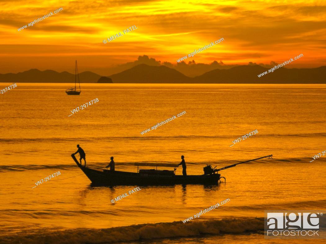 Stock Photo: Longtail boat silohuette - Krabi, Thailand.
