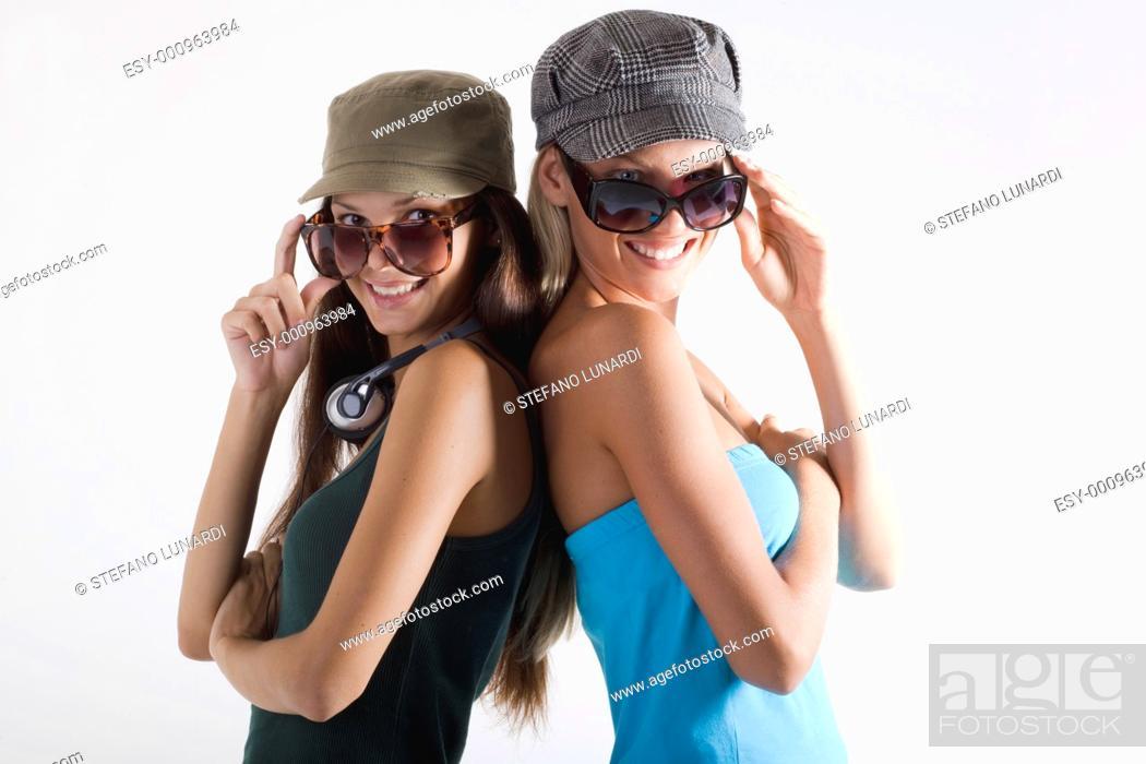 Stock Photo: Trendy teenage girls on white background.