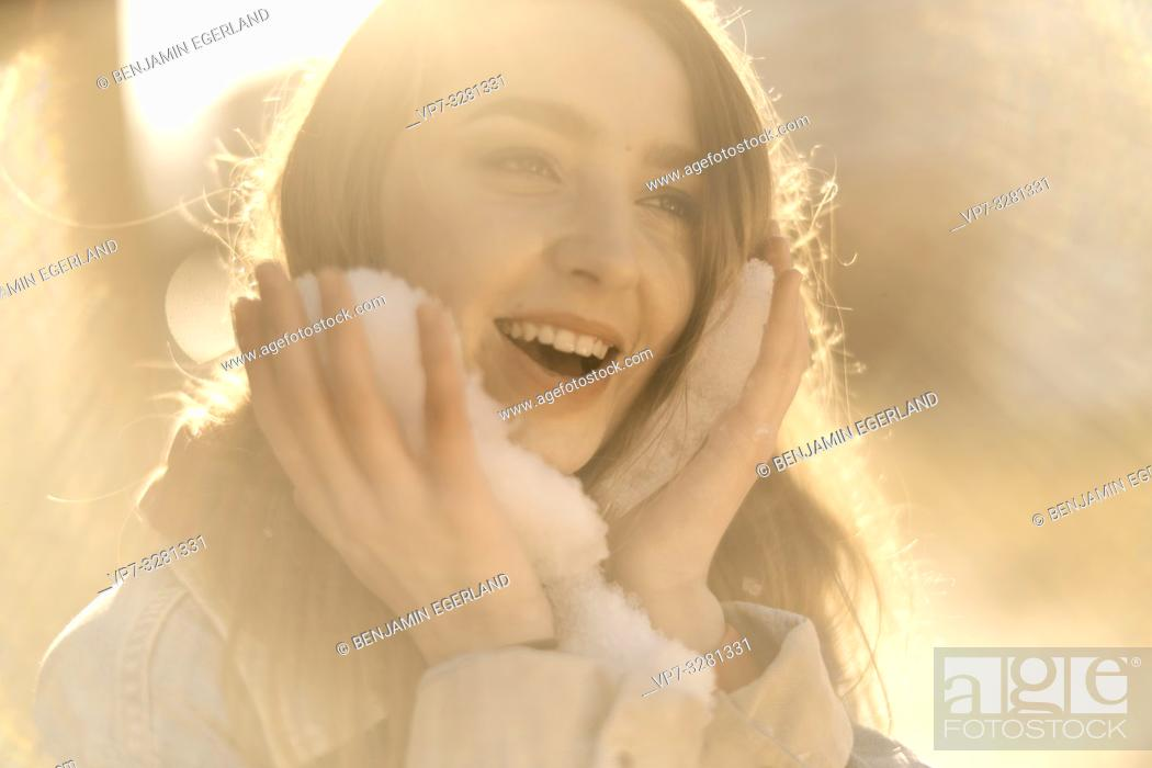 Stock Photo: young woman with snow, winter season, in Cottbus, Brandenburg, Germany.