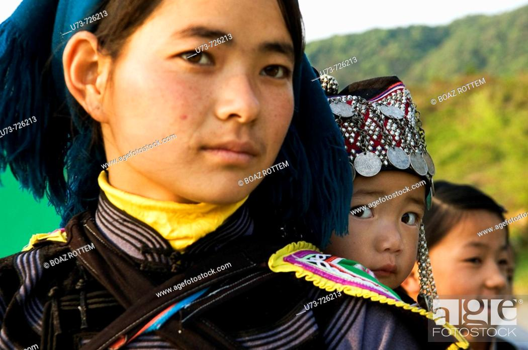 Stock Photo: A Hani  Akha woman with her baby.