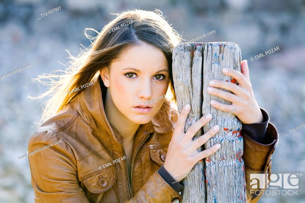 Stock Photo: Pretty young woman is posing outdoors.