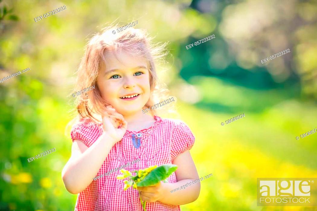 Stock Photo: Happy little girl playing in sunny park.
