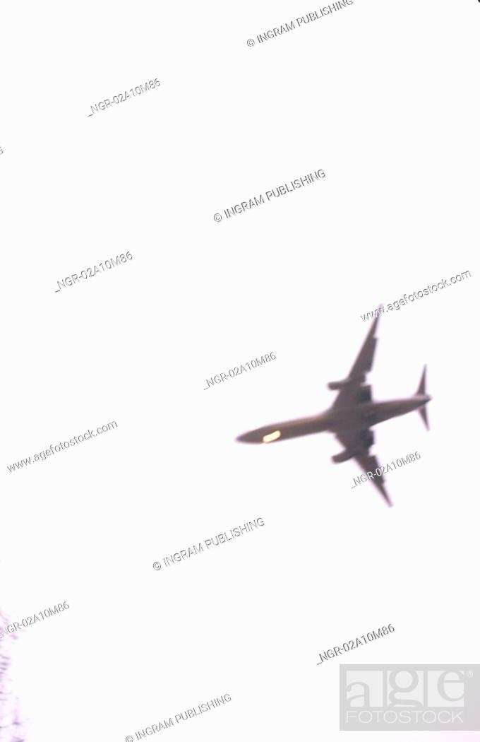 Stock Photo: Airplane Flying Overhead.