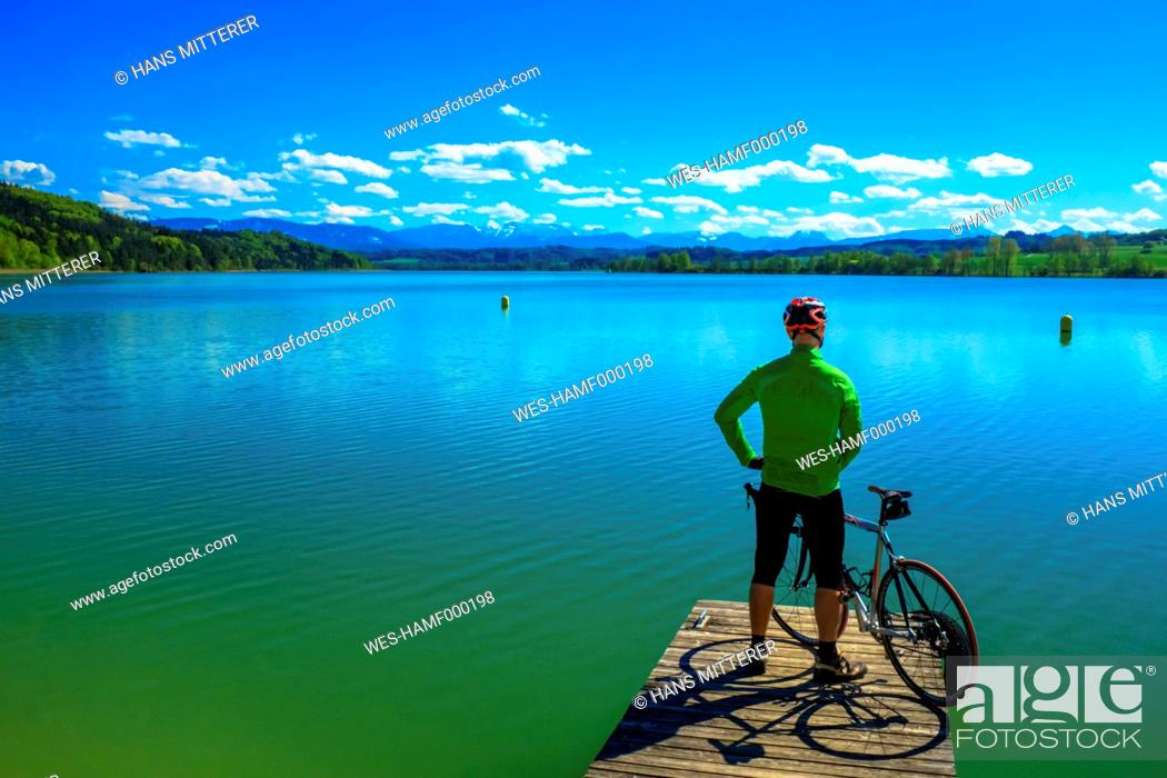 Photo de stock: Germany, Rupertigau, Waginger See, man with bicycle standing on pier.