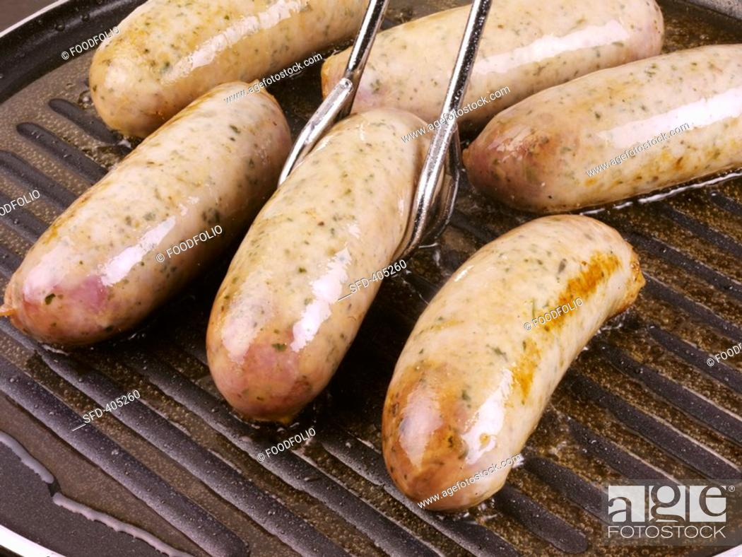 Stock Photo: Sausages in a grill pan Not available for exclusive usages.